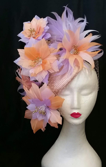 hats by zarbella mannequin wearing a custom made flowery hat