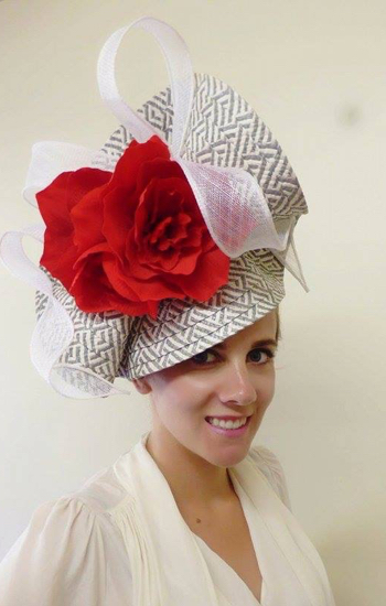 girl with large red flowered hats by zarbella racewear headpiece